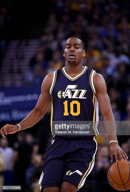 Alec Burks of the Utah Jazz dribbles the ball up court against the Golden State Warriors during their NBA basketball game at ORACLE Arena on December...