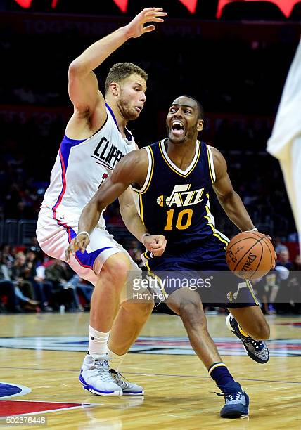 Alec Burks of the Utah Jazz drives on Blake Griffin of the Los Angeles Clippers at Staples Center on November 25 2015 in Los Angeles California