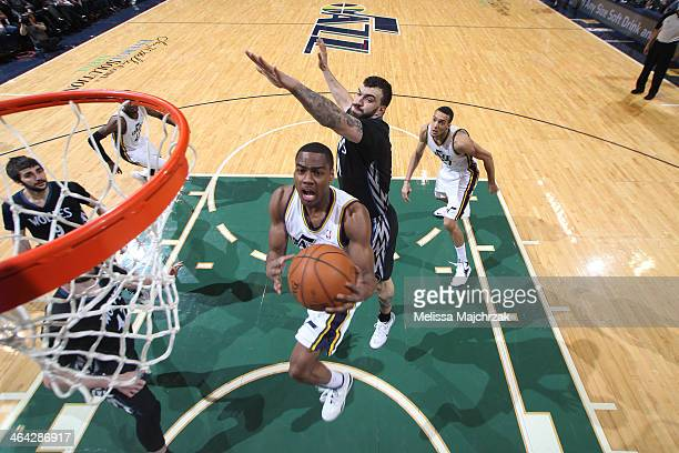 Alec Burks of the Utah Jazz drives to the basket against the Minnesota Timberwolves at EnergySolutions Arena on January 21 2014 in Salt Lake City...