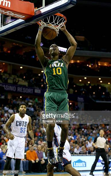 Alec Burks of the Utah Jazz dunks the ball against the Charlotte Bobcats during their game at Time Warner Cable Arena on December 21 2013 in...