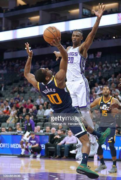 Alec Burks of the Utah Jazz fall off balance getting his shot off over Harry Giles of the Sacramento Kings during the first half of their NBA...