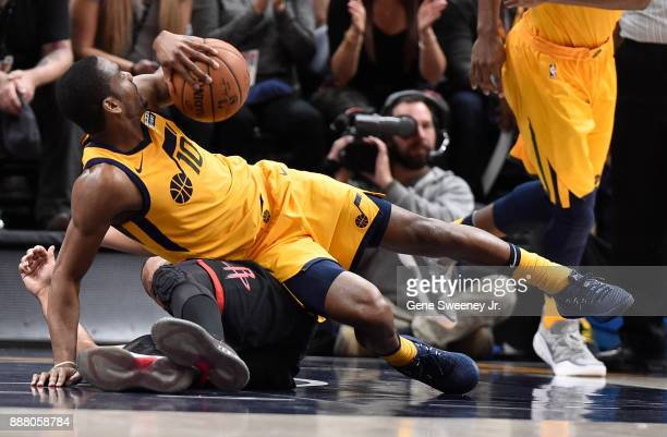 Alec Burks of the Utah Jazz falls over Eric Gordon of the Houston Rockets in the second half of the 112101 win by the Rockets at Vivint Smart Home...