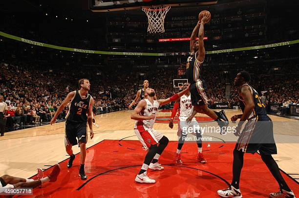 Alec Burks of the Utah Jazz goes up for a dunk against the Toronto Raptors during the game on November 15 2014 at the Air Canada Centre in Toronto...