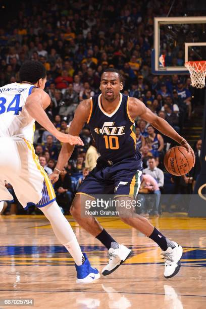 Alec Burks of the Utah Jazz handles the ball against the Golden State Warriors on April 10 2017 at ORACLE Arena in Oakland California NOTE TO USER...