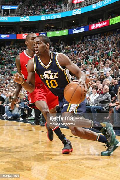 Alec Burks of the Utah Jazz handles the ball against the Los Angeles Clippers on December 26 2015 at vivintSmartHome Arena in Salt Lake City Utah...