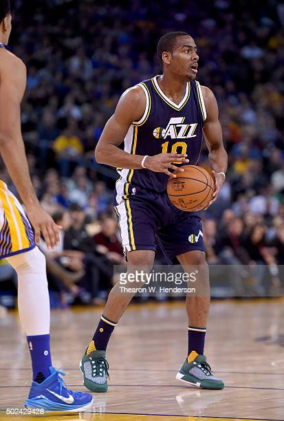 Alec Burks of the Utah Jazz looks to pass the ball against the Golden State Warriors during their NBA basketball game at ORACLE Arena on December 23...