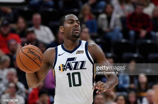 Alec Burks of the Utah Jazz looks to pass the ball in the second half of a preseason NBA game against the Adelaide 36ers at Vivint Smart Home Arena...