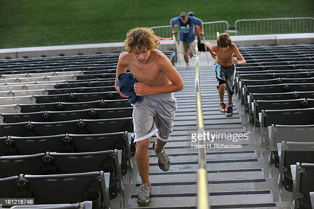 Alec Ferris left and Seth Egan make their way up the stadium stairs In its third year Step Up for Cancer has over 40 Colorado nonprofit cancer...