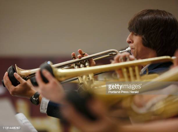 Alec Fisichella a senior at Mount Desert Island High School plays lead trumpet during a performance at the Maine State High School Instrumental Jazz...