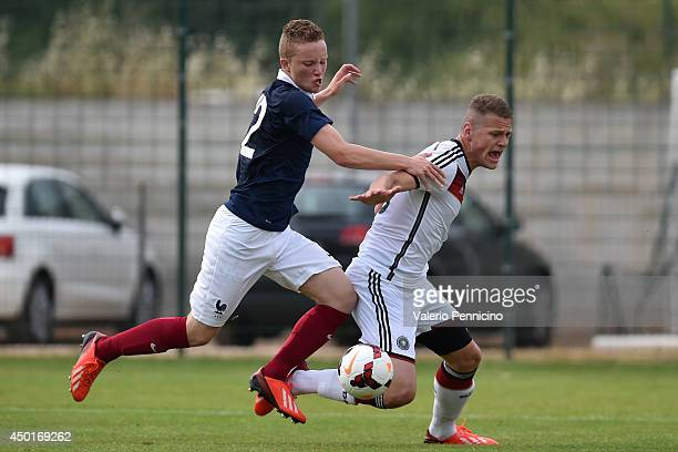 Alec Georgen of France tackles Ilker Yuksel of Germany during the International Friendly match between U16 France and U16 Germany at Stade Perruc on...