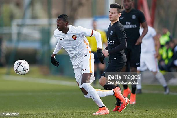 Alec Georgen of PSG battles is beaten to the ball by Sadiq Umar of Roma during the UEFA Youth League Quarterfinal match between Paris Saint Germain...