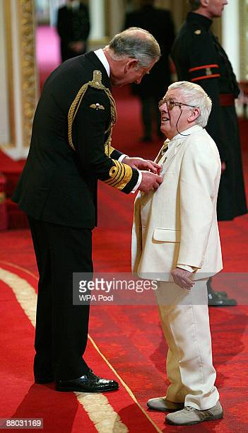 Alec Gill from Hull receives the MBE from the Prince Charles Prince of Wales for services to the fishing community in KingstonuponHulduring...