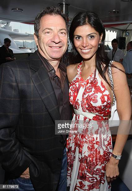 Alec Gores and Sheila Shah attend the Paradigm Agency Party held on the Bud Light Yacht during the 61st Cannes Film Festival on May 18 2008 in Cannes...