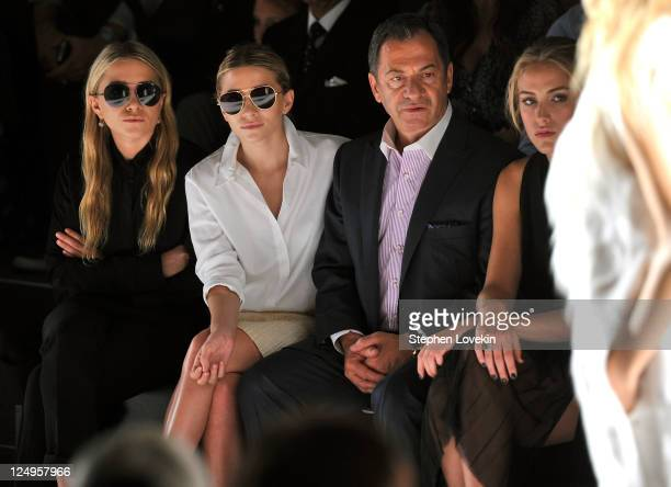 Alec Gores MaryKate Olsen and Ashley Olsen attend the JMendel Spring 2012 Fashion Show at Lincoln Center on September 14 2011 in New York City