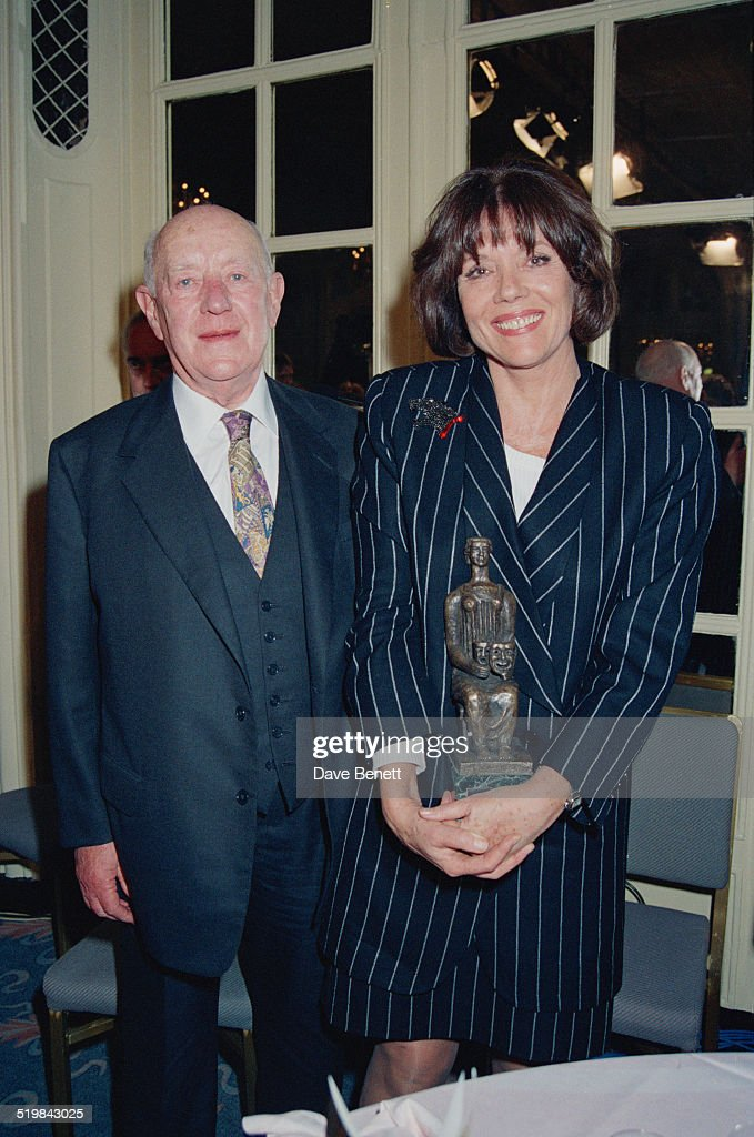 Alec Guinness (1914 -2000) and Diana Rigg at the Evening Standard Theatre Awards, held at the Savoy Hotel, London, 10th November 1992. Rigg is holding her award for Best Actress, for 'Medea'.