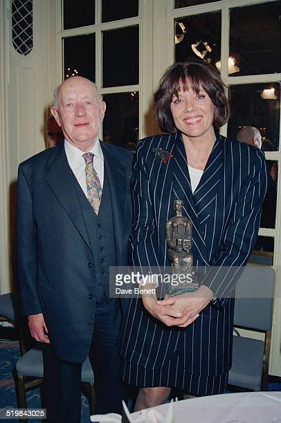 Alec Guinness and Diana Rigg at the Evening Standard Theatre Awards held at the Savoy Hotel London 10th November 1992 Rigg is holding her award for...