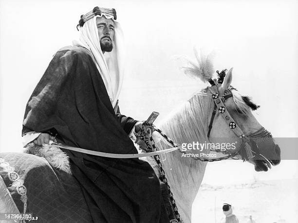 Alec Guinness on horse back in a scene from the film 'Lawrence Of Arabia' 1962