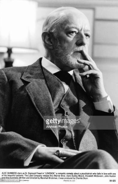 Alec Guinness sitting in concentration in a scene from the film 'Lovesick' 1983