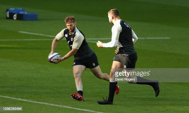 Alec Hepburn breaks with the ball watched by Elliott Stooke during the England captain's run held at Twickenham Stadium on November 2 2018 in London...
