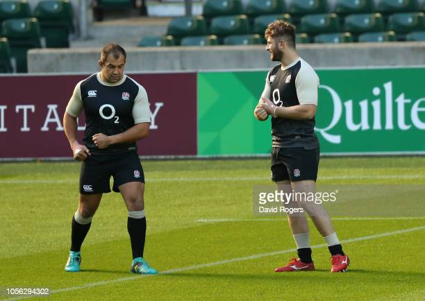 Alec Hepburn looks on with team mate Elliott Stooke during the England captain's run held at Twickenham Stadium on November 2 2018 in London England