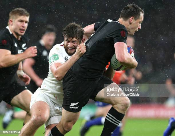 Alec Hepburn of England tackles Ben Smith of New Zealand during the Quilter International match between England and New Zealand at Twickenham Stadium...