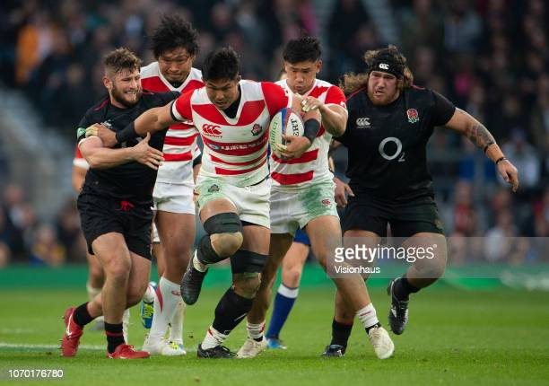 Alec Hepburn of England tackles Kazuki Himeno of Japan during the Quilter International match between England and Japan on November 17 2018 in London...