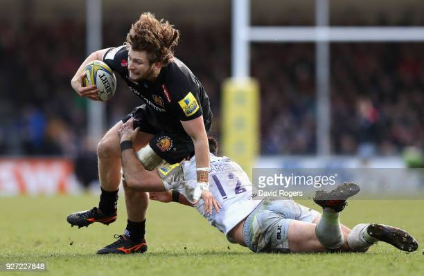 Alec Hepburn of Exeter Chiefs is tackled by Brad Barritt during the Aviva Premiership match between Exeter Chiefs and Saracens at Sandy Park on March...