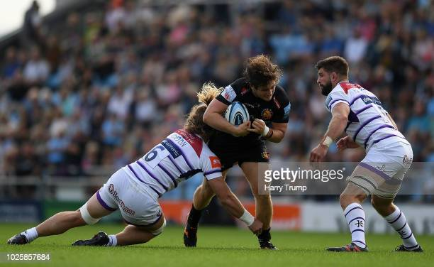 Alec Hepburn of Exeter Chiefs is tackled by David Denton of Leicester Tigers during the Gallagher Premiership Rugby match between Exeter Chiefs and...