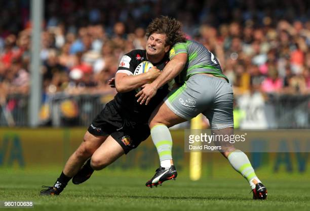 Alec Hepburn of Exeter Chiefs is tackled by Kyle Cooper of Newcastle Falcons during the Aviva Premiership Semi Final between Exeter Chiefs and...
