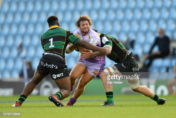 Alec Hepburn of Exeter Chiefs is tackled by Manny Iyogun and Teimana Harrison of Northampton Saints during the Heineken Champions Cup Quarter Final...