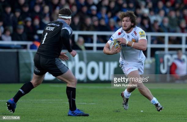 Alec Hepburn of Exeter Chiefs runs at Rob Vickers of Newcastle Falcons during the Aviva Premiership match between Newcastle Falcons and Exeter Chiefs...