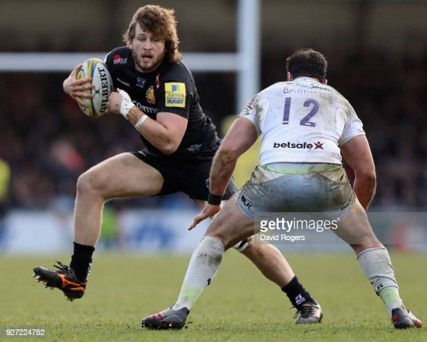 Alec Hepburn of Exeter Chiefs takes on Brad Barritt during the Aviva Premiership match between Exeter Chiefs and Saracens at Sandy Park on March 4...