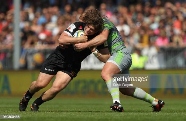 Alec Hepburn of Exeter is tackled by Kyle Cooper during the Aviva Premiership Semi Final between Exeter Chiefs and Newcastle Falcons at Sandy Park on...