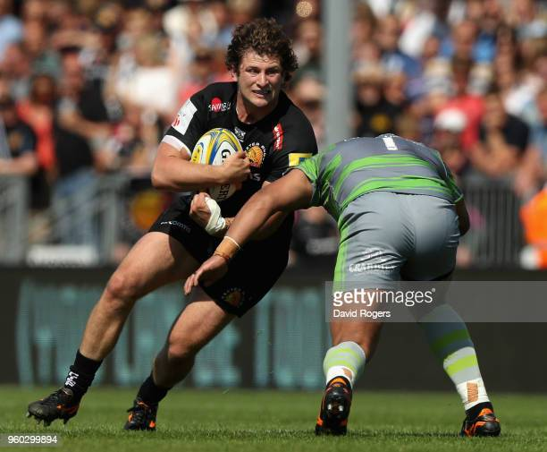 Alec Hepburn of Exeter takes on Sam Lockwood during the Aviva Premiership Semi Final between Exeter Chiefs and Newcastle Falcons at Sandy Park on May...