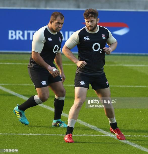 Alec Hepburn warms up with team mate Ben Moon during the England captain's run held at Twickenham Stadium on November 2 2018 in London England