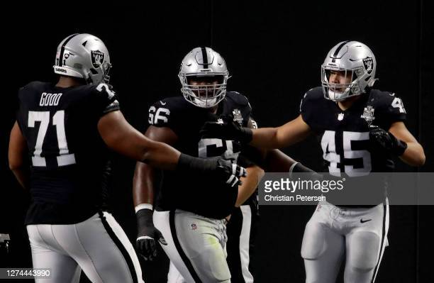 Alec Ingold of the Las Vegas Raiders celebrates a touchdown with Denzelle Good and Gabe Jackson during the second quarter against the New Orleans...