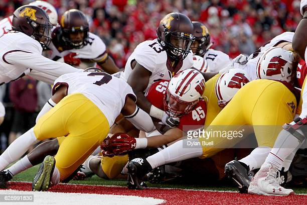 Alec Ingold of the Wisconsin Badgers scores a touchdown in the second quarter against the Minnesota Golden Gophers at Camp Randall Stadium on...