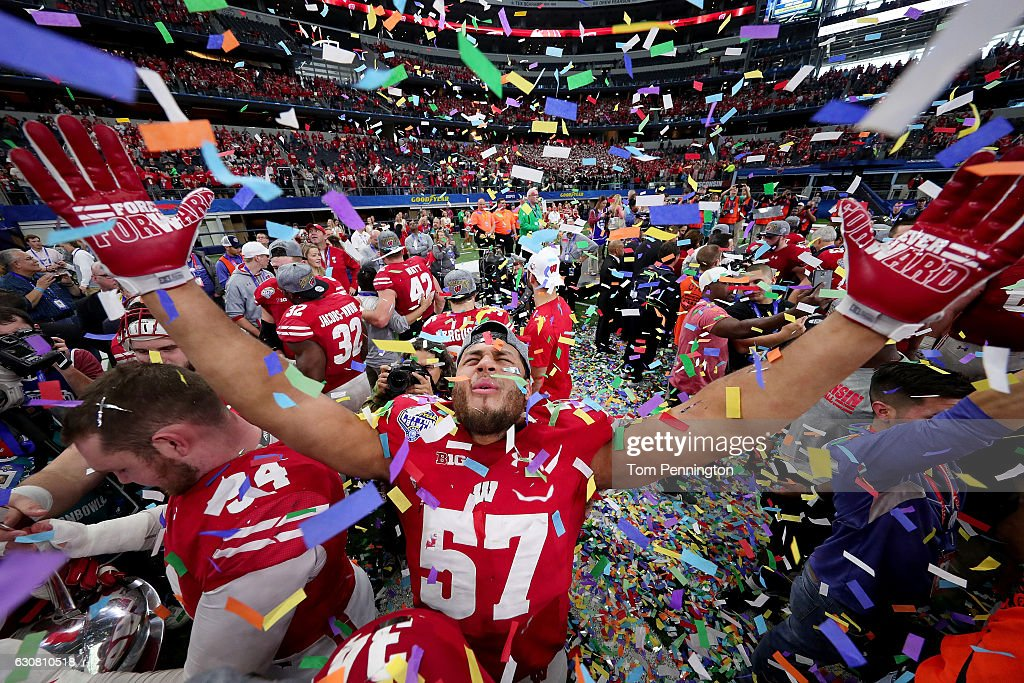 Alec James #57 of the Wisconsin Badgers celebrates after the Wisconsin Badgers beat the Western Michigan Broncos 24-16 in the 81st Goodyear Cotton Bowl Classic at AT&T Stadium on January 2, 2017 in Arlington, Texas.