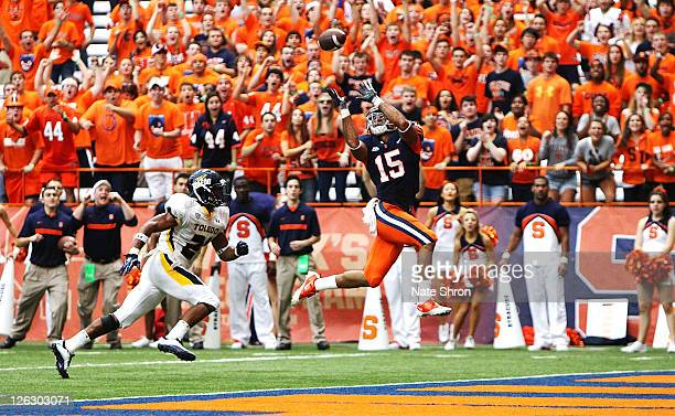 Alec Lemon catches a TD for the Syracuse Orange in the game against the Toledo Rockets on September 24, 2011 at the Carrier Dome in Syracuse, New...