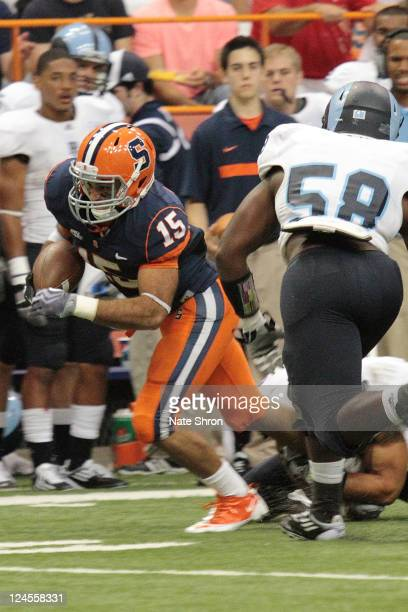 Alec Lemon of the Syracuse Orange runs down the field against Rhode Island Rams Kenny Smith during the game on September 10, 2011 at the Carrier Dome...
