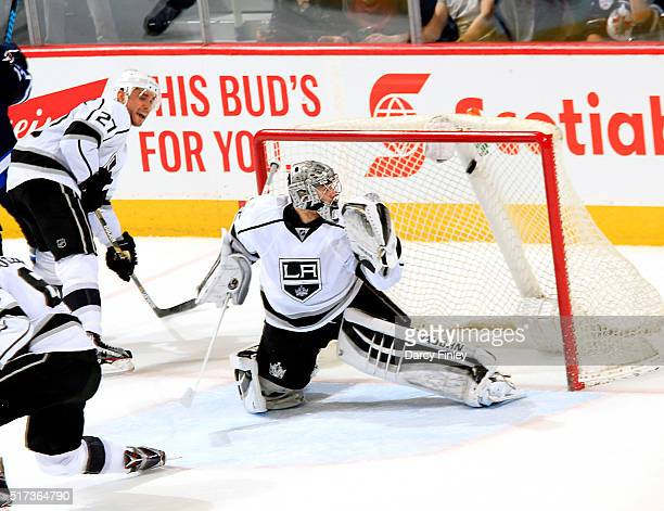 Alec Martinez and goaltender Jonathan Quick of the Los Angeles Kings react as the puck shot by Adam Lowry of the Winnipeg Jets goes into the net for...