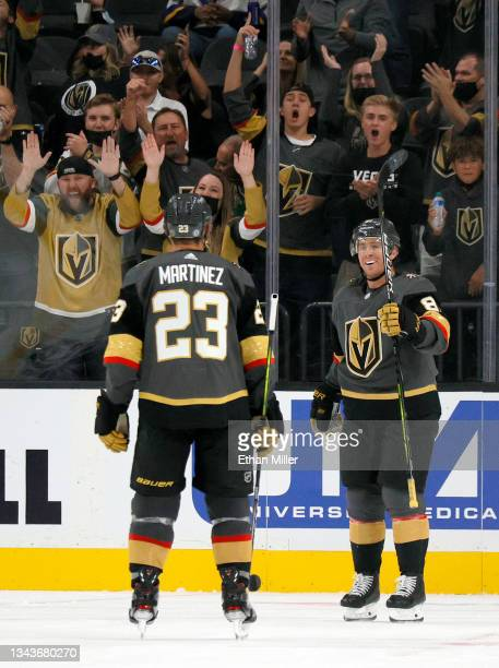 Alec Martinez and Jonathan Marchessault of the Vegas Golden Knights celebrate Marchessault's third-period power-play goal against the Colorado...