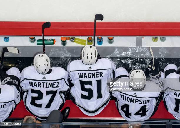 Alec Martinez Austin Wagner and Nate Thompson of the Los Angeles Kings looks on from the bench during second period action against the Winnipeg Jets...