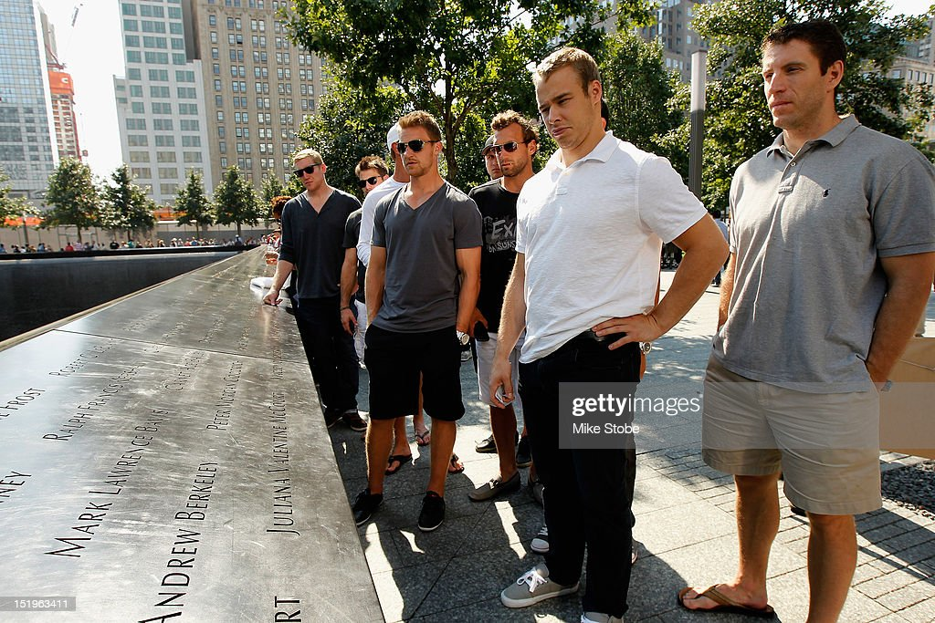 Alec Martinez, Kyle Clifford, Matt Greene, Jarret Stoll, Rob Scuderi, Dustin Brown, Trevor Lewis, Kevin Westgrath, Jeff Carter and Brad Richardson of the Los Angeles Kings stand at the engraved names of Garnet 'Ace' Bailey, the Kings' director of pro scouting, and amateur scout Mark Bavis in lower Manhattan at the World Trade Center site on September 13, 2012 in New York City.The Los Angeles Kings felt the loss of Garnet 'Ace' Bailey, the Kings' director of pro scouting, and amateur scout Mark Bavis when hijackers took control of their scheduled Boston-to-Los Angeles flight and crashed the plane into the south tower of New York's World Trade Center.