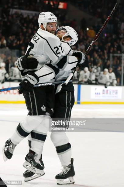 Alec Martinez of the Los Angeles Kings and Jake Muzzin of the Los Angeles Kings celebrate Martinez's goal during the third period at Staples Center...