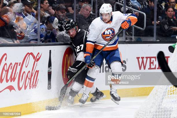 Alec Martinez of the Los Angeles Kings and Ryan Pulock of the New York Islanders battle for the puck during the third period of the game at STAPLES...