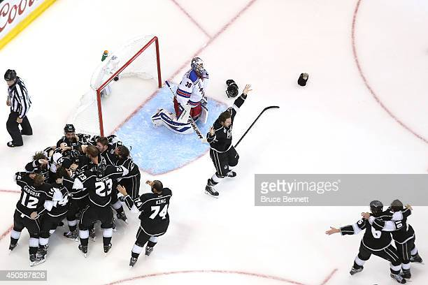 Alec Martinez of the Los Angeles Kings and the Kings celebrate after scoring the game-winning goal in double overtime against goaltender Henrik...