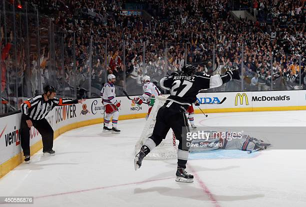 Alec Martinez of the Los Angeles Kings celebrates after scoring the game-winning double overtime goal against goaltender Henrik Lundqvist of the New...
