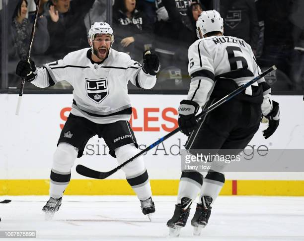Alec Martinez of the Los Angeles Kings celebrates his goal with Jake Muzzin to take a 10 lead over the Carolina Hurricanes during the third period at...