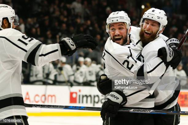 Alec Martinez of the Los Angeles Kings celebrates his goal with Jake Muzzin of the Los Angeles Kings and Alex Iafallo of the Los Angeles Kings during...